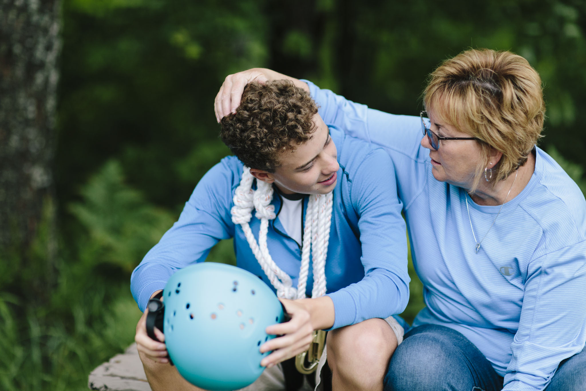 A mom and her son talk following an experience on the high ropes course