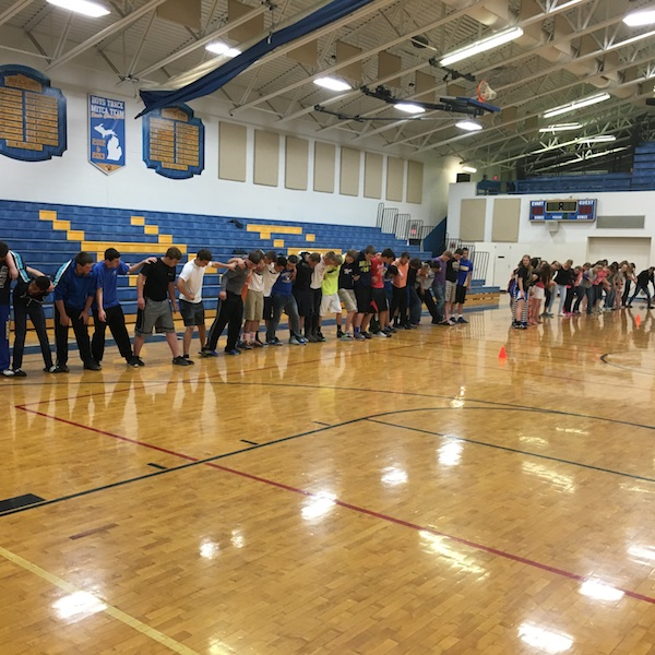 High schoolers participate in a Victors Edge challenge in their own gym